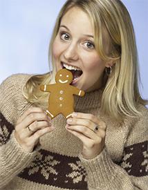 women-eating-gingerbread-man-cookie_1